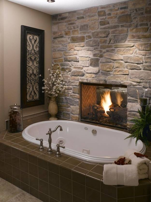 9. If you have a bathroom that shares a wall with your bedroom, build a fireplace between the two to keep both warmed by a calming fire.
