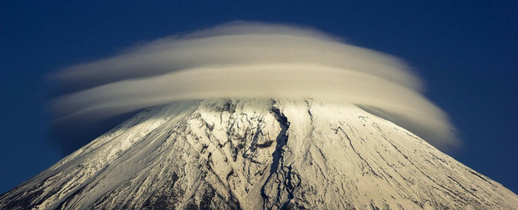 Incredible Photos Of UFO-Shaped Clouds Swirling Atop Mountains From Around The World