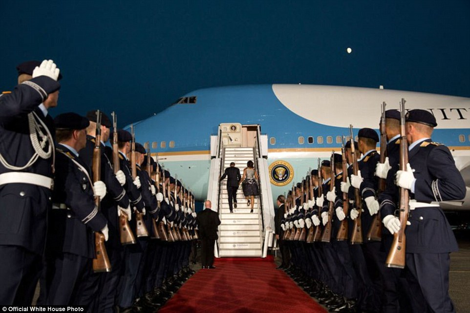 President Barack and Michelle Obama board Air Force One