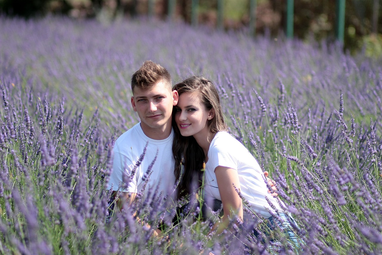 couple in the field of flower