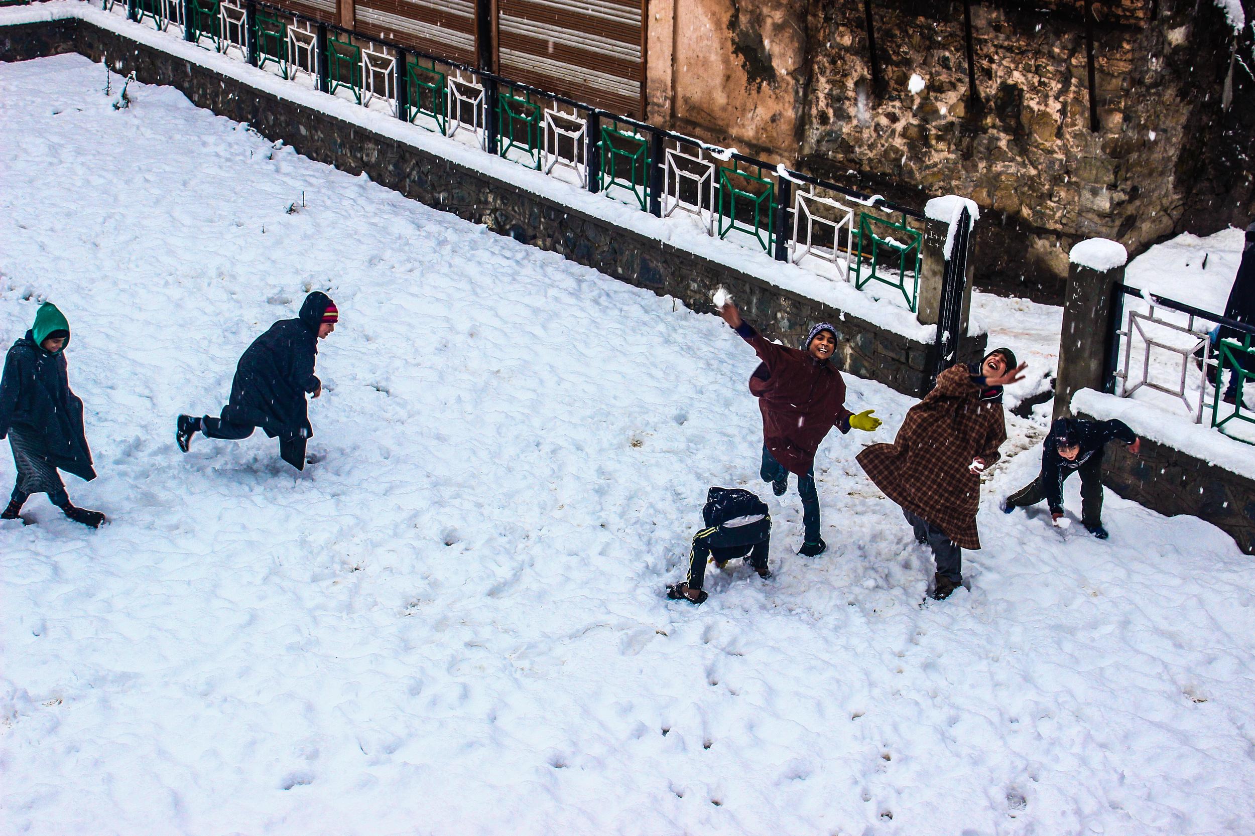 Boys Hurl Snowballs
