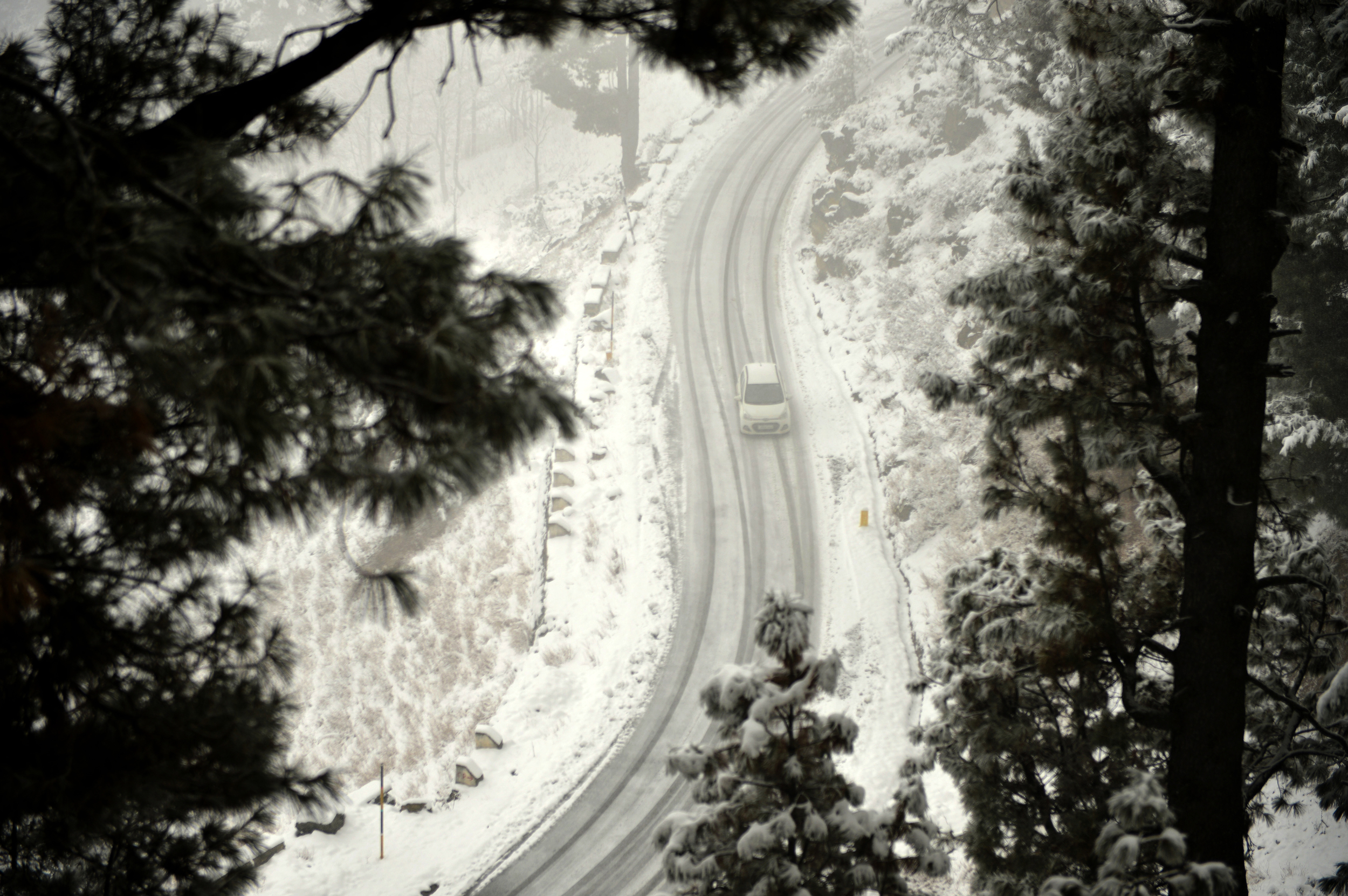 Vehicle Travels Along A Snow Covered Road