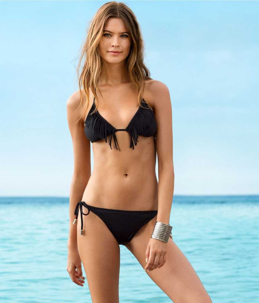 Behati Prinsloo Shows Off Her Enviable Figure In Tiny Bikini On Photoshoot