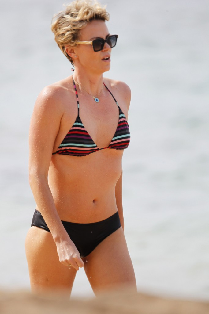 Charlize Theron Displays Her Flawless Figure In  Different Bikinis During Beachside Photo Shoot