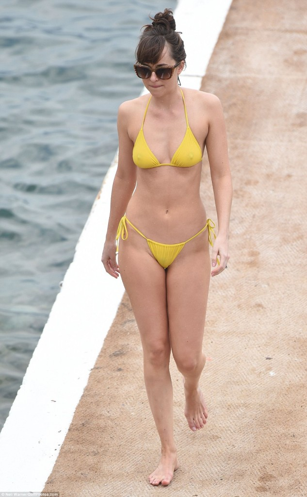 Dakota Johnson Wears Very Skimpy Yellow Bikini While Lounging On The Beach