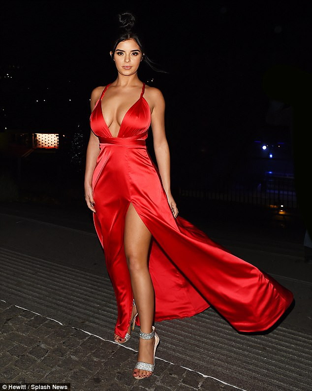 Demi Rose Flaunts Her Ample Cleavage In A Plunging Red Silk Dress