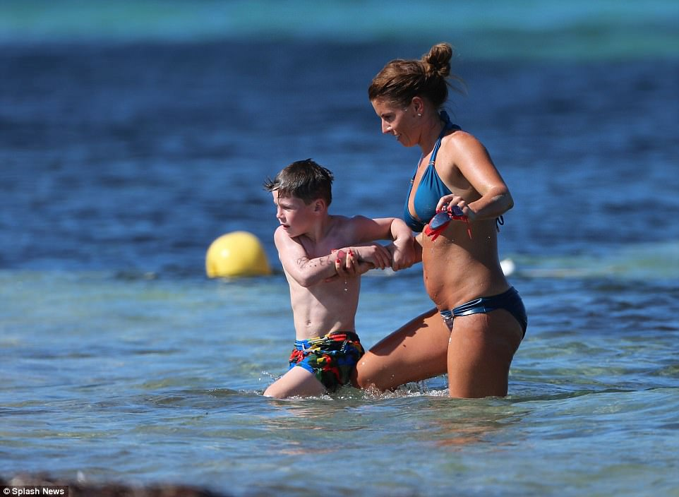 Coleen Rooney Slips Her Enviable Curves Into Skimpy Pastel Bikini