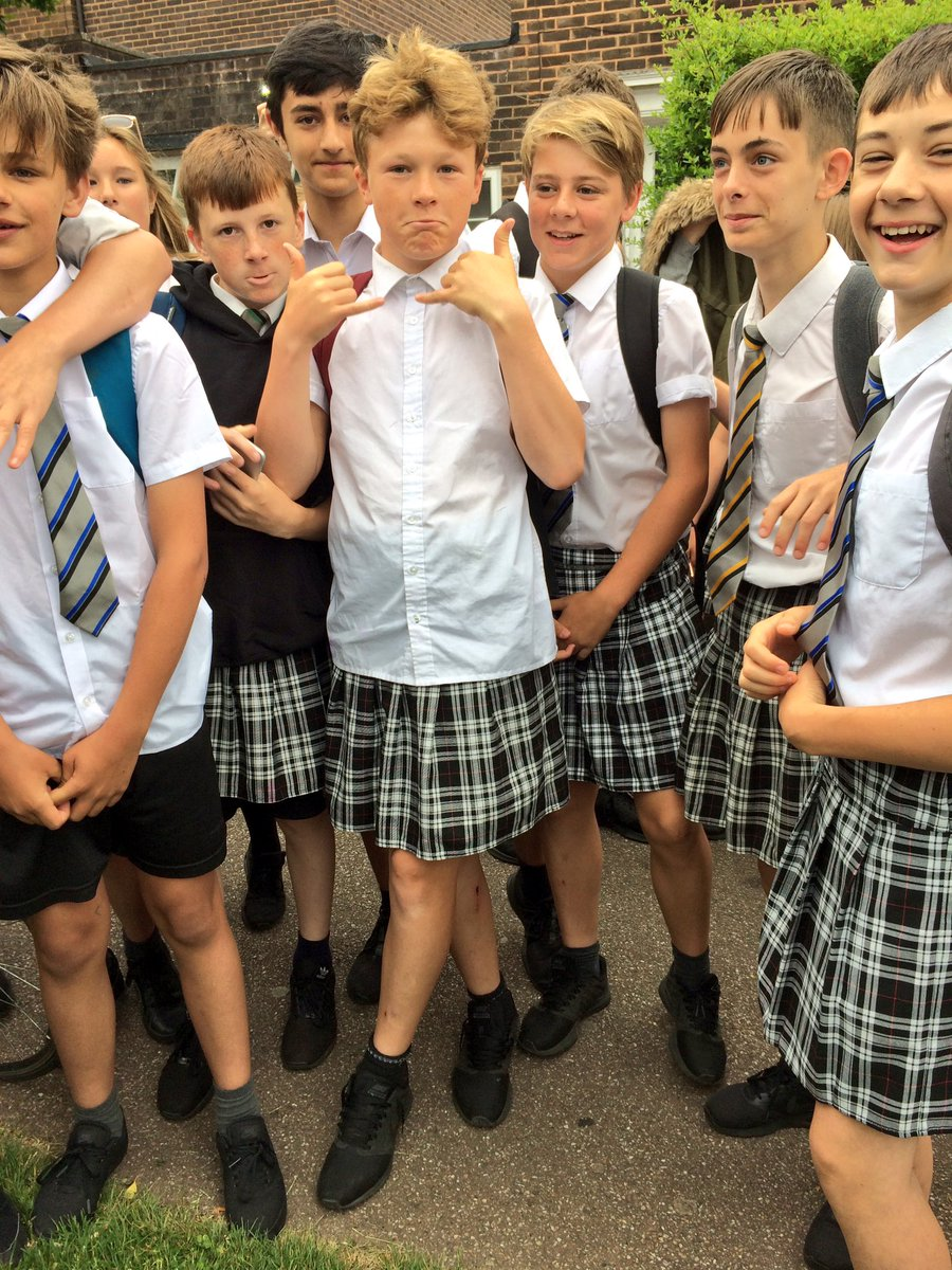 Teenage boys wear skirts to protest against 'no shorts' policy