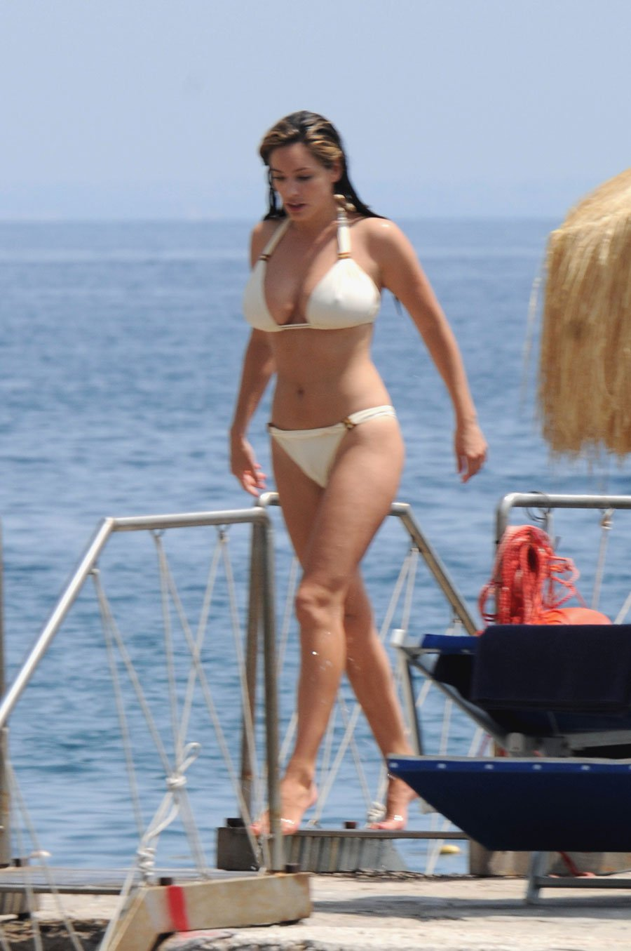 Kelly Brook Shows Off Her Famous Curves In Hot Bikinis