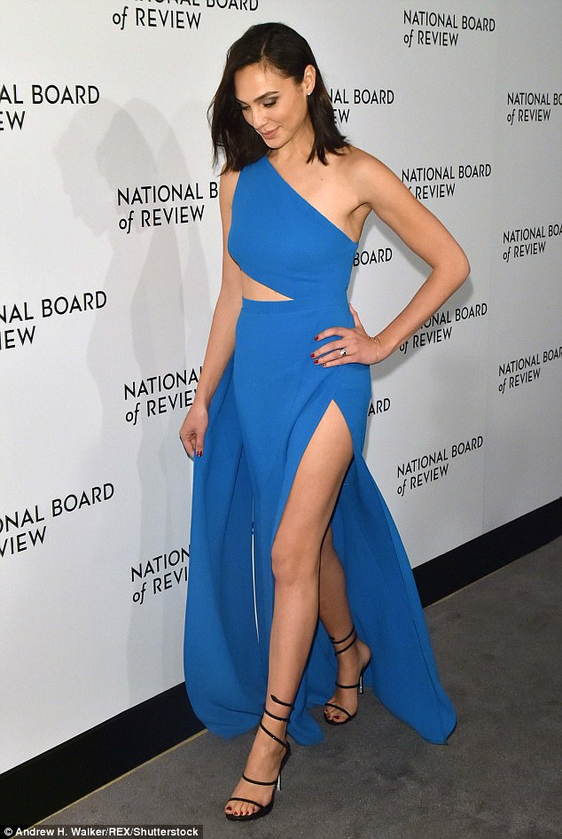 Gal Gadot Flashes Some Leg In Blue Grecian Style Gown As She Stuns At New York Gala