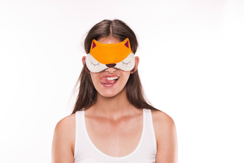 A Sleeping Mask or Ear Plugs