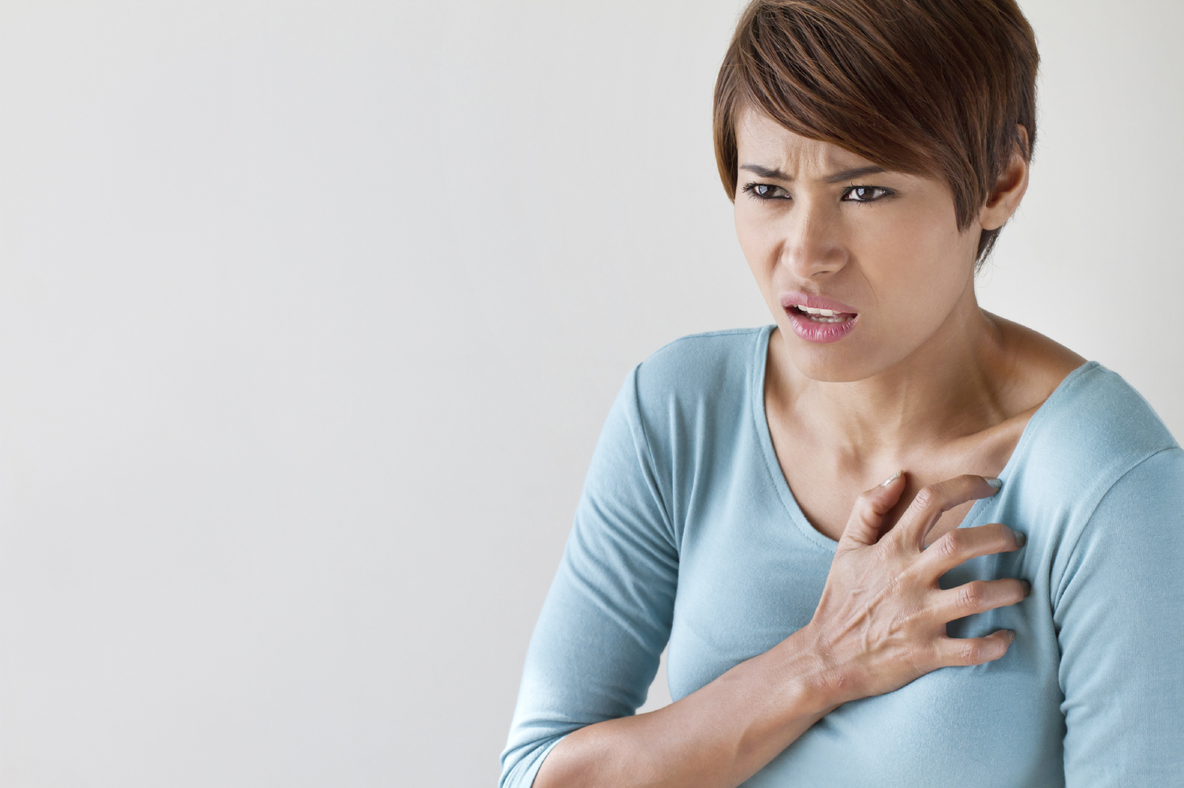 sick woman with sudden heart attack symptom