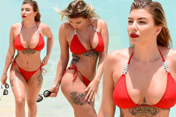 Olivia Buckland Shows Off Her Tattooed Curves In Tiny Bikini