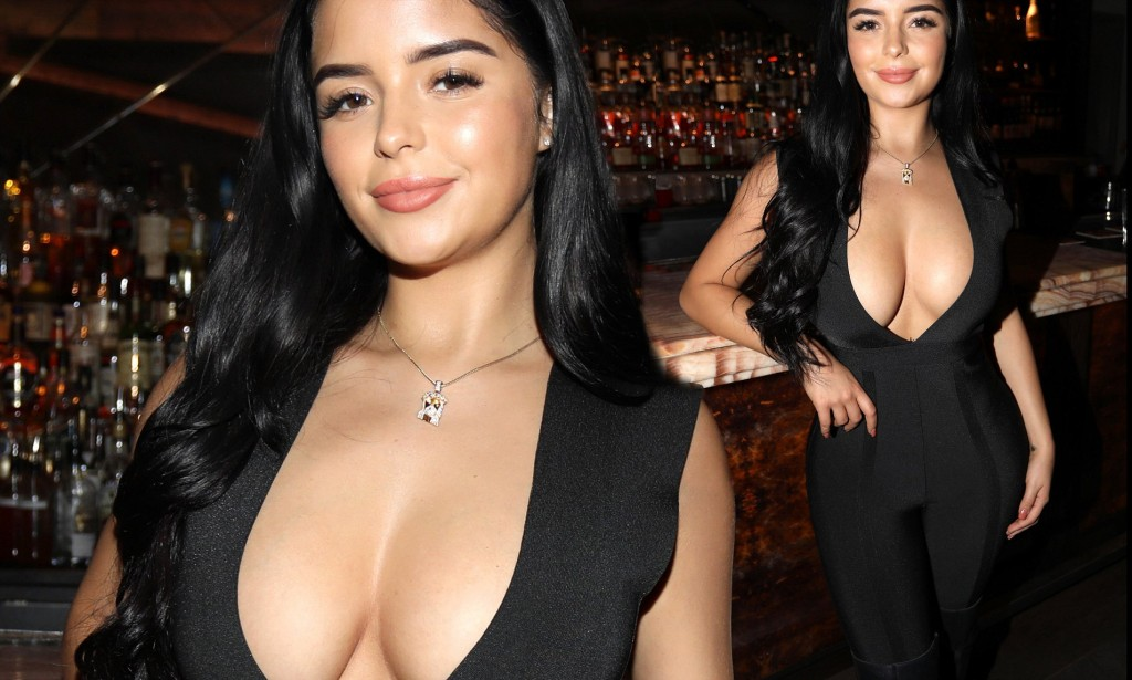 Demi Rose Flaunts Her Eye Popping Assets In A Perilously Plunging Clingy Jumpsuit