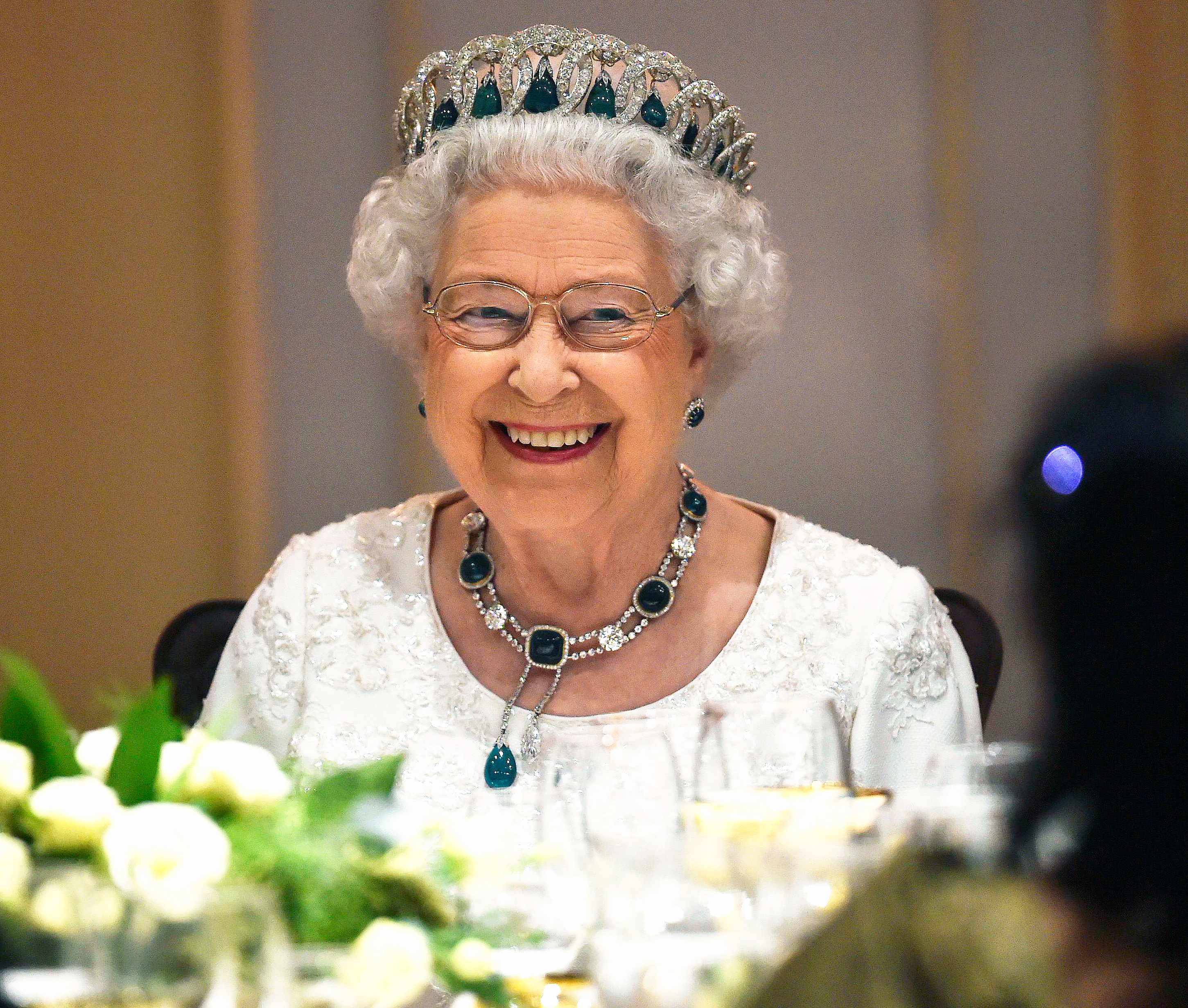 Britain's Queen Elizabeth smiles as she attends a dinner at the Corinthia Palace Hotel - Malta