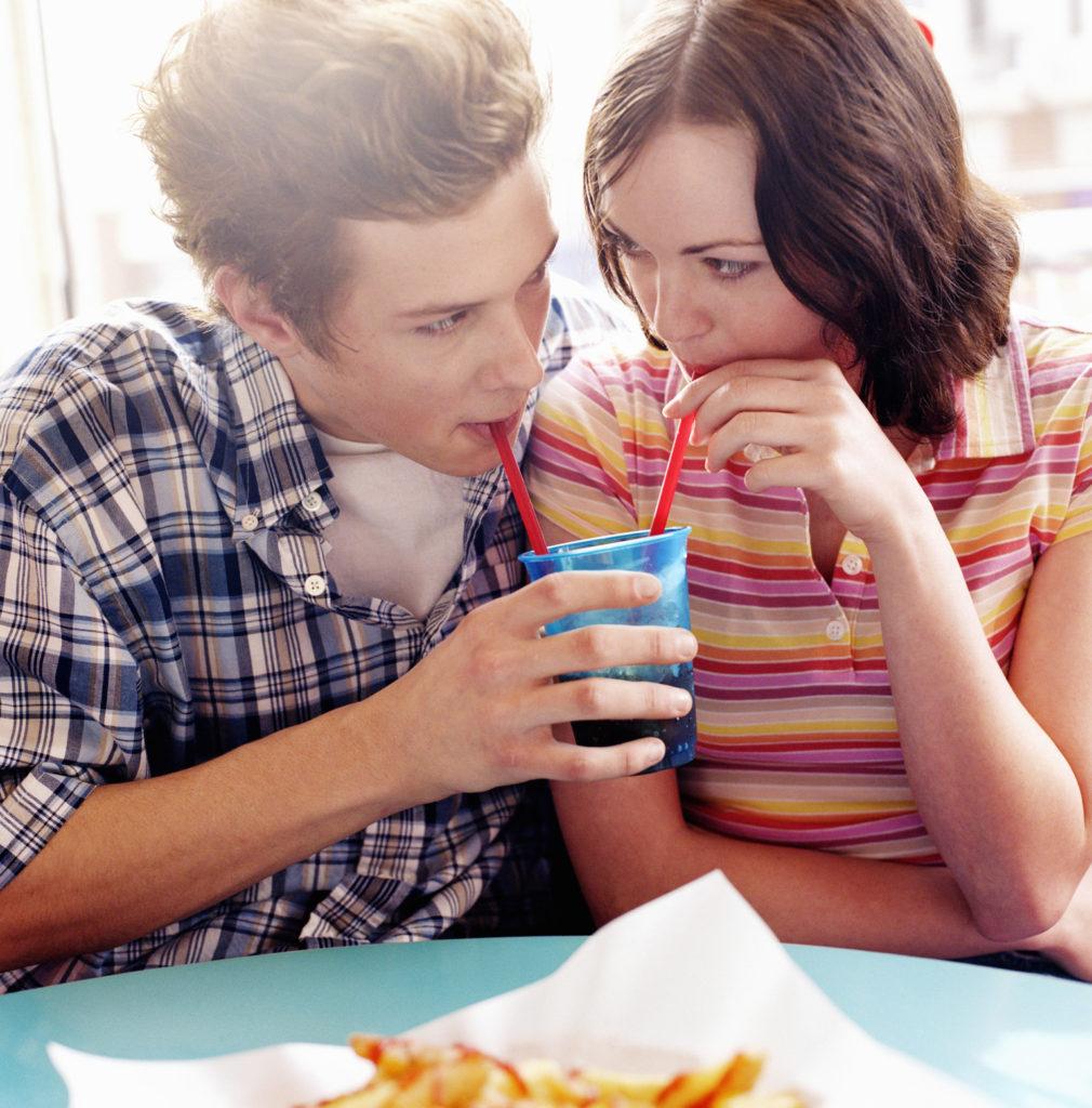 Teenage Couple Share Drink