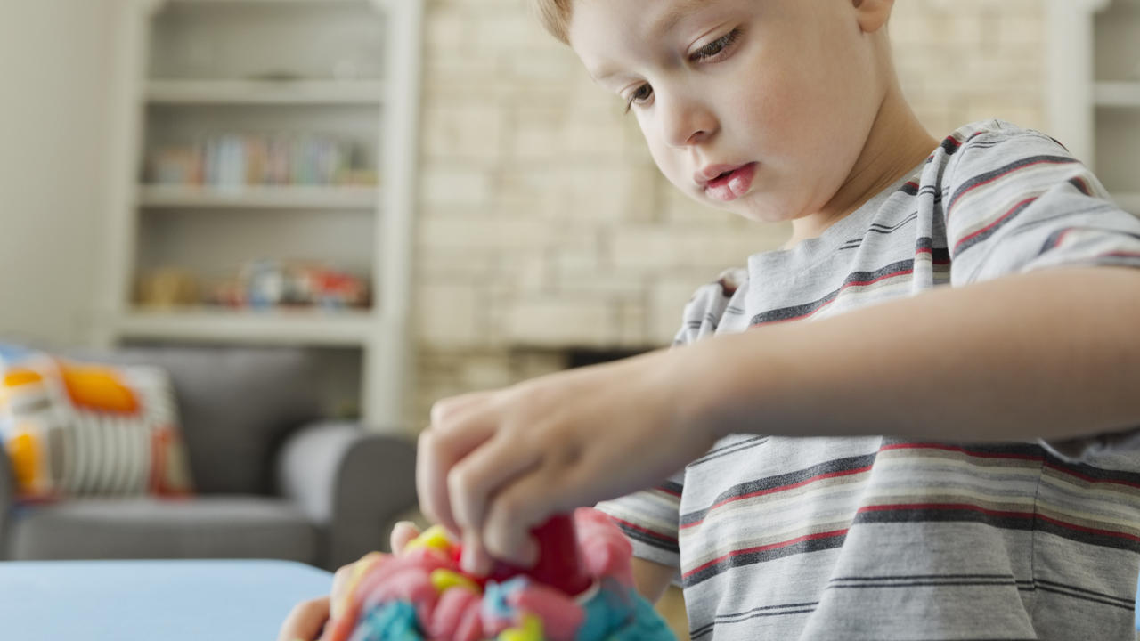 Boy playing with play dough