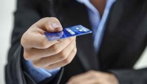 man holding credit card