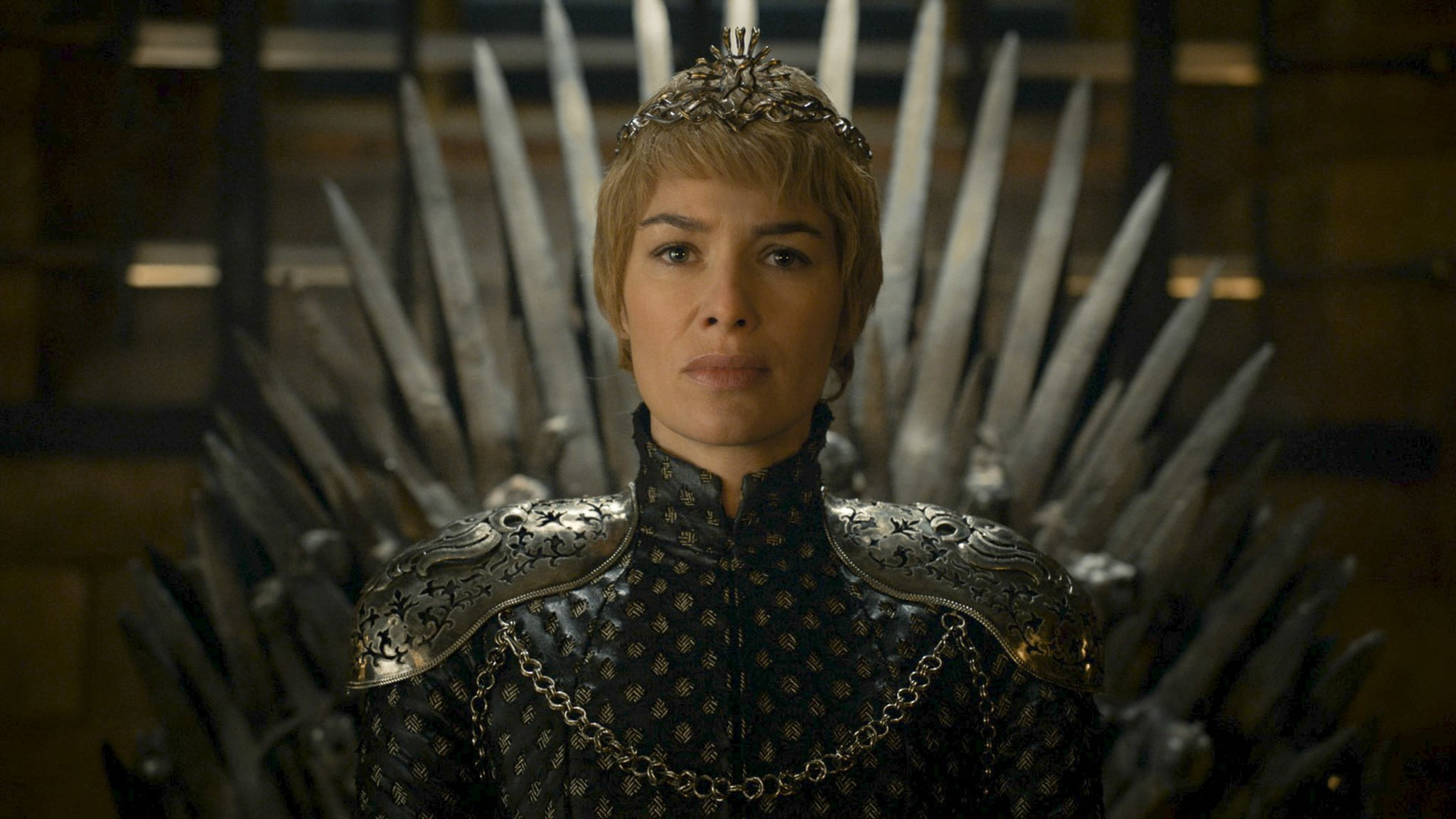 Cersei on the Iron Throne has Qyburn