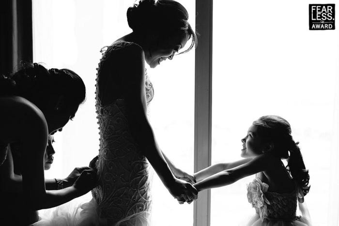 Photographers captured moments of joy between brides and their support systems.